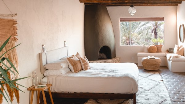 Ocotillo Suite is split level with one king bed, one queen bed, a living room and fireplace, and bathroom.