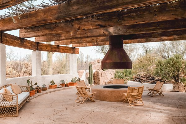 A campfire pit allows for guests to gather and connect amid a garden of cacti.