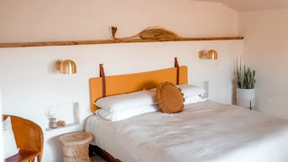The Yucca Room sit son the lower level with one king bed, one bathroom, fireplace, and a private patio.