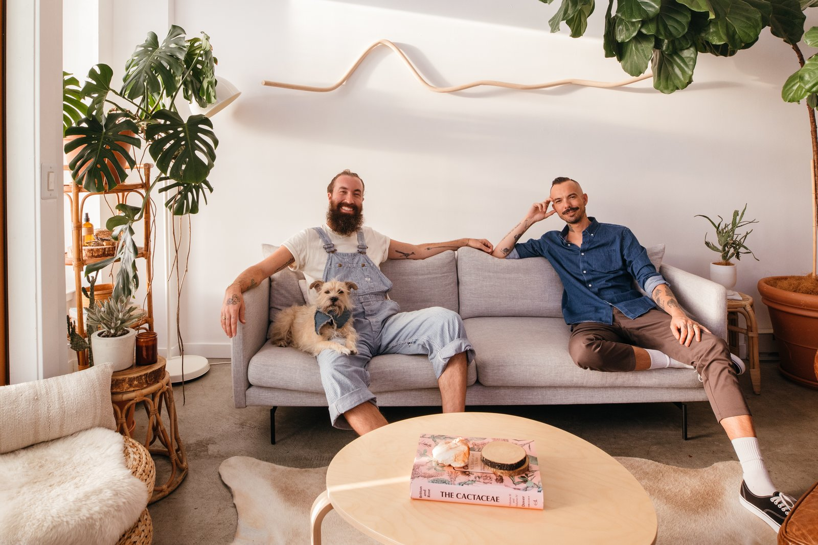 Joey the pup, Jimmy Brower, and Damien Merino chill in their live/work loft.