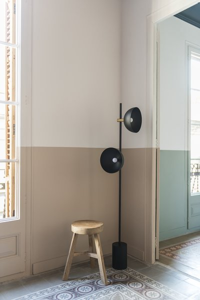 A valance runs around walls, doors and windows, creating an artificial horizon, visually widening spaces in an otherwise vertically proportioned property.