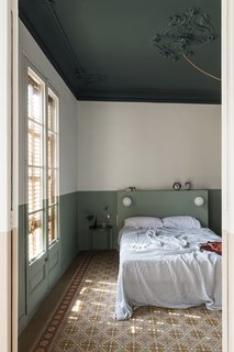 Old meets new with original tile, updated moulding, and a contemporary splash of paint.