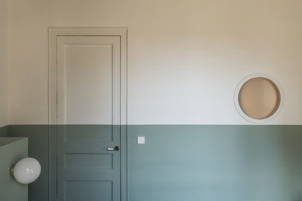 A porthole alongside the walk-in closet allows natural light to flow into the bedroom.