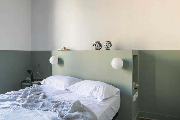 The built-in headboard doubles as storage with cubbies on either side.