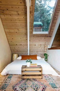 A view of the cozy guest bedroom in the main residence.