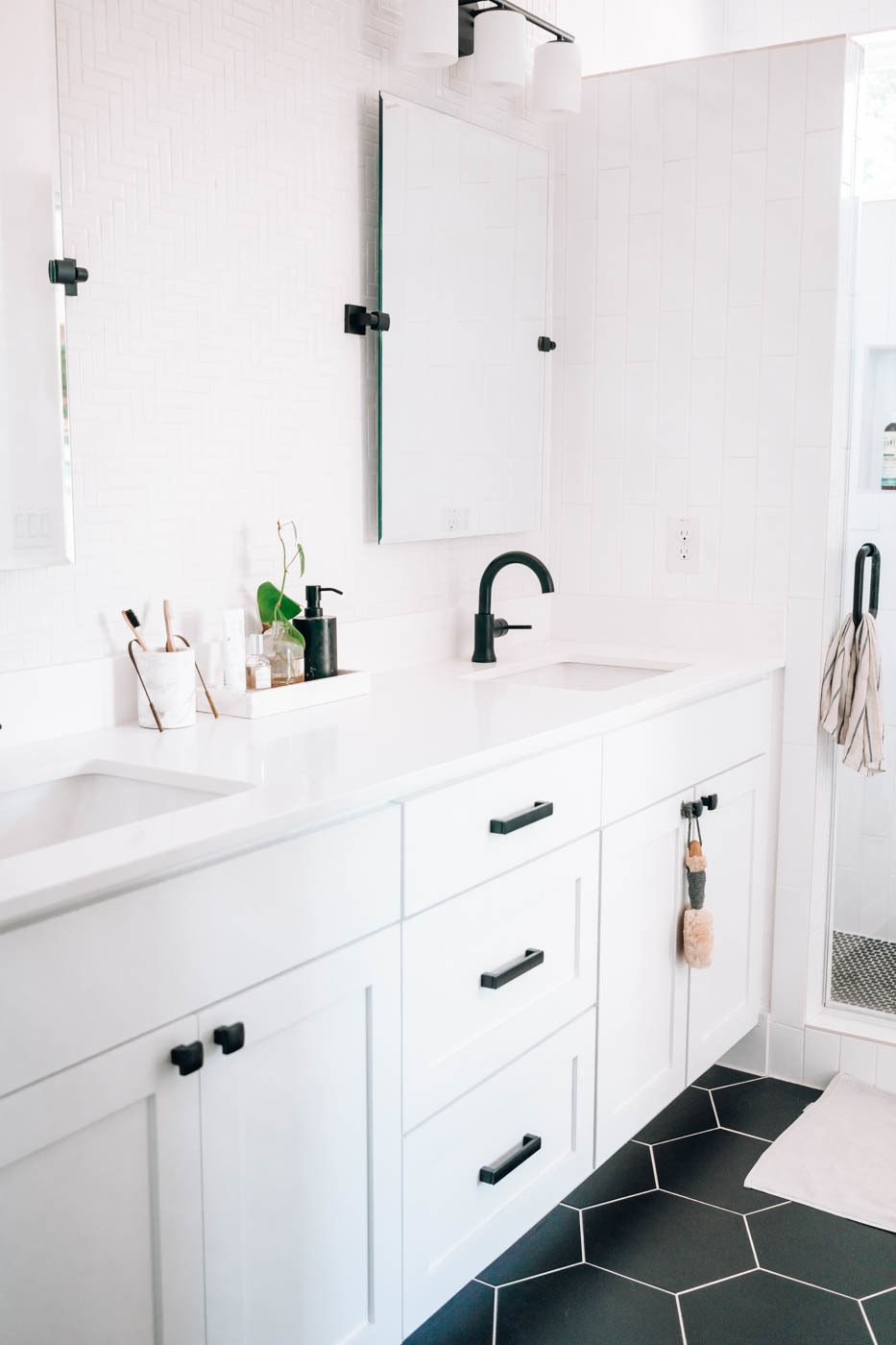 Bath Room, Laminate Counter, Wall Lighting, Ceramic Tile Floor, Enclosed Shower, Drop In Sink, and Two Piece Toilet The bathroom is clean and minimal to maintain a serene (and easy-to-clean) environment.  Photo 8 of 8 in My House: A Wellness Blogger Carves Out a Soothing Retreat in Austin