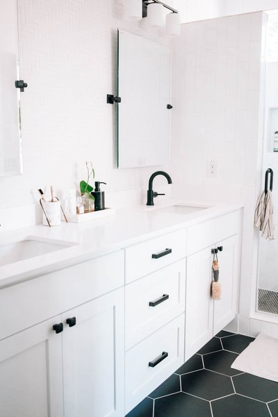 The bathroom is clean and minimal to maintain a serene (and easy-to-clean) environment.