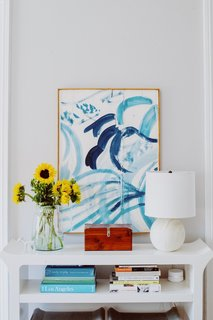 Ocean hues run throughout Amanda's home. The apartment she shares with her husband is nestled in the heart of downtown Charleston, a few blocks from Colonial Lake.
