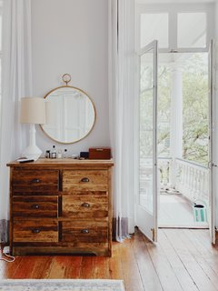 """""""A big part of the reason I sought out the apartment we live in now was due to its amazing bones and architectural details,"""" says Amanda. """"The 12-foot ceilings, French doors, and fireplaces that date back to the late 1800s feel like a little dose of Paris in Charleston."""""""