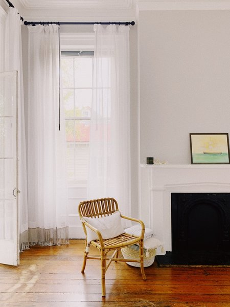 """""""I have some small paintings from an Artist named Barbara Irwin,"""" says Amanda. """"Currently a ship on our bedroom mantel, and a whale above our bed. A few years ago I purchased France & Son's take on a Jeanneret chair. You see them a lot of places now, but I still love it."""""""