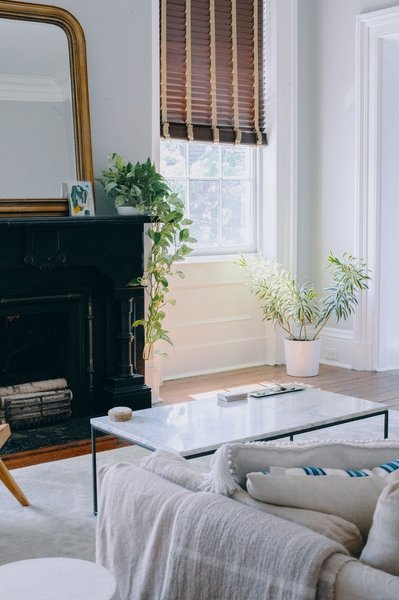 Vintage items complement contemporary pieces like a coffee table from West Elm and lighting from Rejuvenation.
