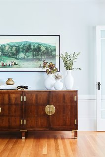 """Custom pieces join both vintage and contemporary furnishings in her home. Clara describes her style as a mix of high and low that's """"often bright, cozy, and with a dose of whimsy."""""""