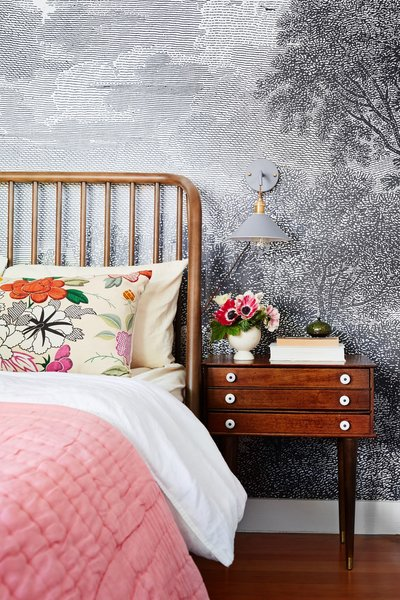Wallpaper and floral patterns liven up another bedroom.