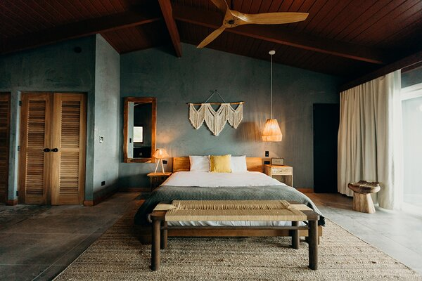 Bedrooms are outfitted with rustic furnishings and woven decor.