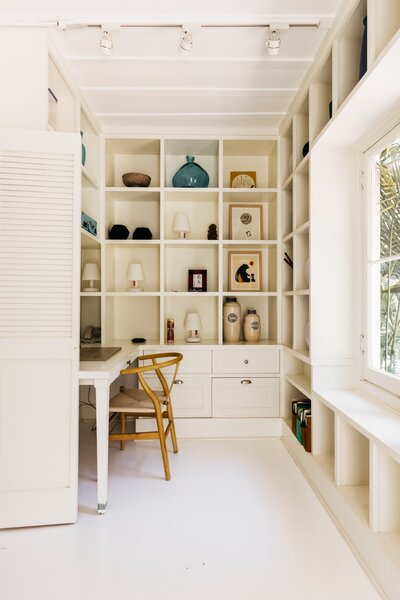 Built-ins are peppered throughout the space to maximize space while dually adding dimension.