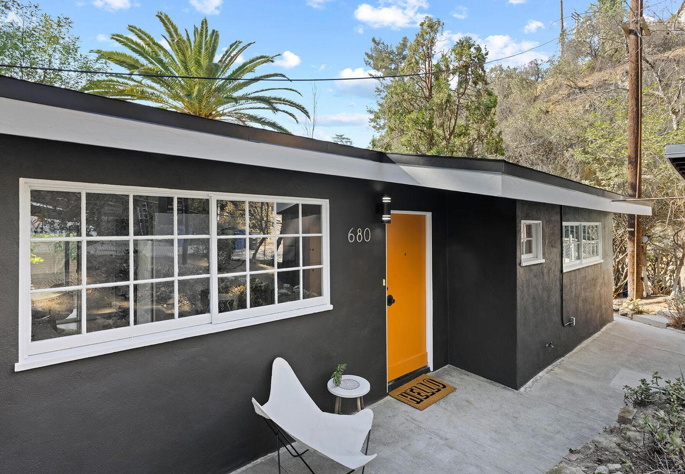 While the home is almost entirely in its original condition, the facade, swathed in a fresh coat of paint feels sleek and modern.  Photo 2 of 10 in A Charming Los Angeles Bungalow Asks $750K