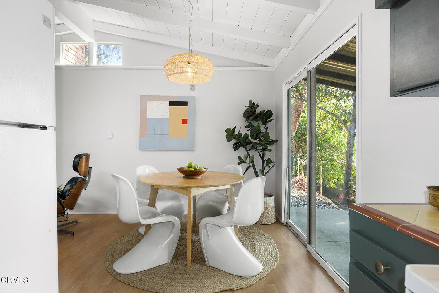 The dining area opens up to the covered patio and yard beyond.  Photo 4 of 10 in A Charming Los Angeles Bungalow Asks $750K
