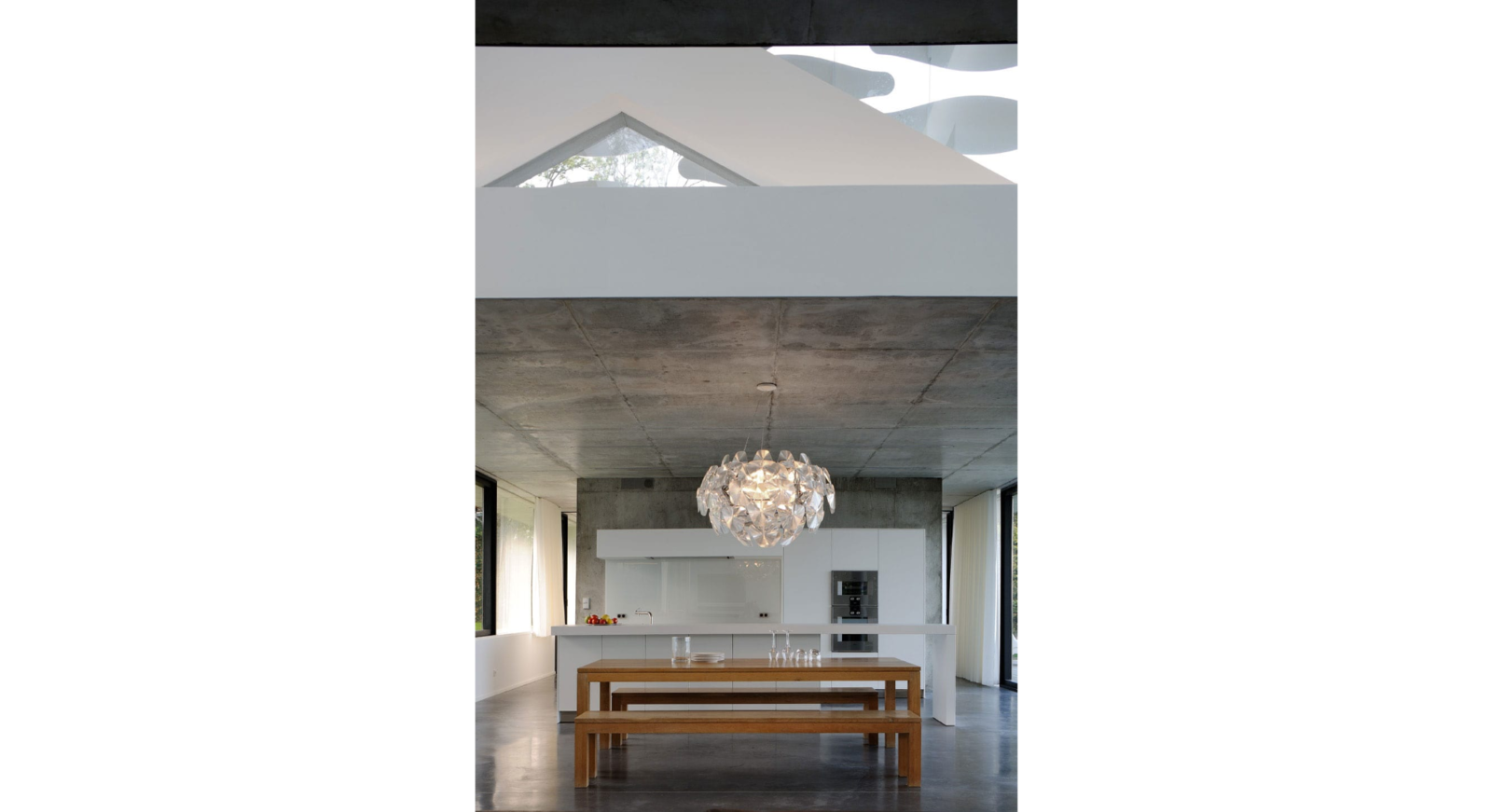 Dining Room, Bench, Ceiling Lighting, Pendant Lighting, and Concrete Floor the custom made table and its kitchen  House on the Lake