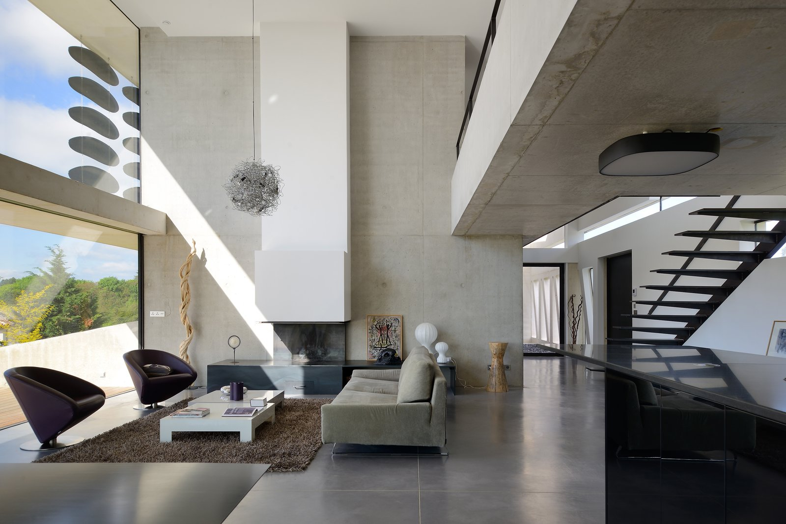 Sofa, Chair, Standard Layout, Concrete, Ceiling, Staircase, Metal, and Metal a ray of light penetrating the livingromm  Best Staircase Chair Standard Layout Photos from Chipster Blister House