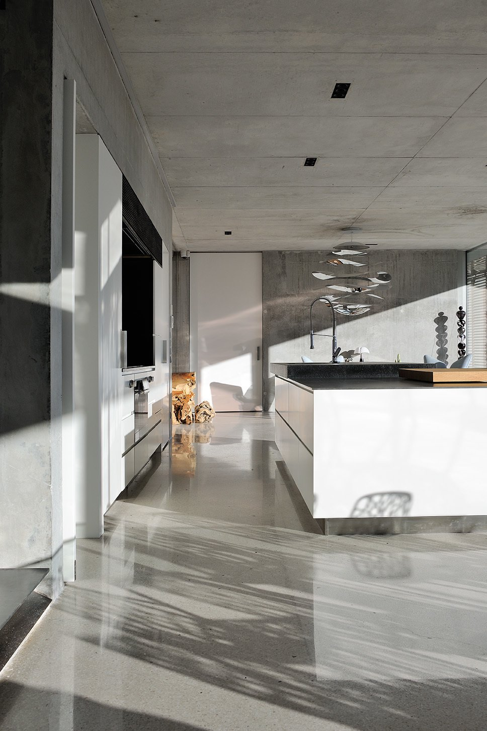 Kitchen, Range, Concrete, Ceiling, Refrigerator, Wall Oven, Concrete, White, Cooktops, and Pedestal The kitchen.  Best Kitchen Range White Wall Oven Concrete Photos from La Mira Ra