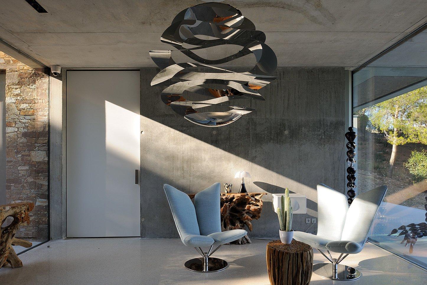Living Room, Sofa, Ceiling Lighting, Concrete Floor, Recessed Lighting, Pendant Lighting, Console Tables, End Tables, and Table Lighting Entering the house.  La Mira Ra