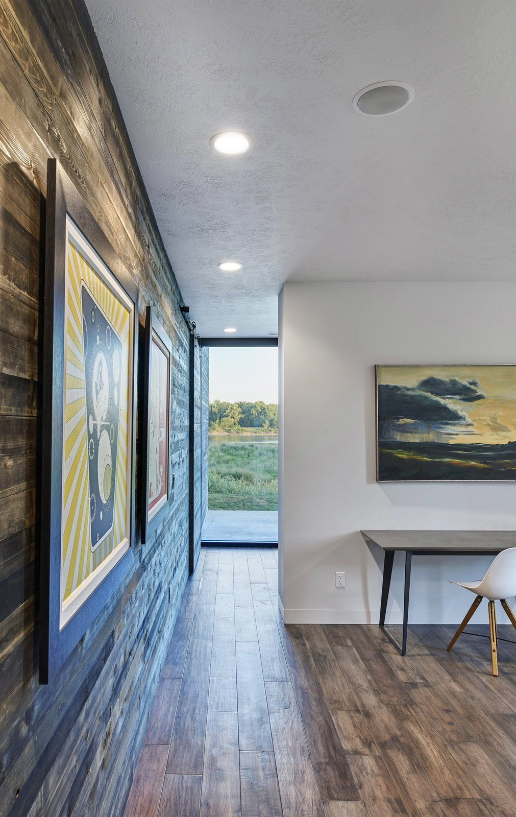 Bedroom, Bed, Chair, Recessed Lighting, and Dark Hardwood Floor View to the Missouri River from the master bedroom. The formerly-exterior, cedar sheathed wall is shown at the left. (2017)  530 house