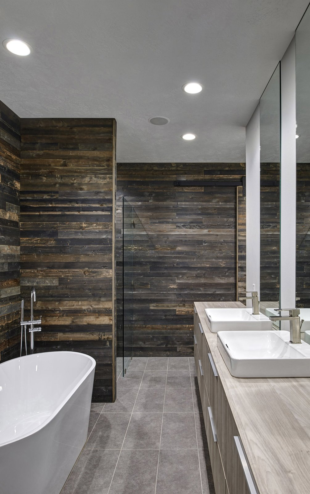 Bath, Wood, Laminate, Ceramic Tile, Vessel, Freestanding, Full, and Recessed View showing the guest bathroom with formerly-exterior  cedar-sheathed walls. (2017)  Best Bath Ceramic Tile Vessel Freestanding Photos from 530 house
