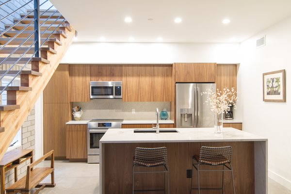 Kitchen with glulam stair