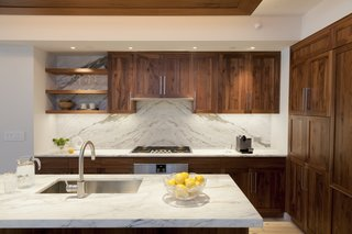 Walnut and book-matched  Calcutta kitchen