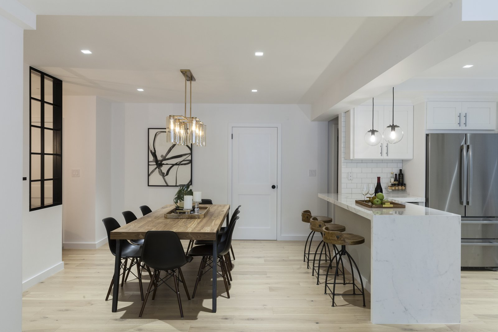 Dining, Pendant, Chair, Accent, Table, Bar, Recessed, Stools, Shelves, Medium Hardwood, Ceiling, and Light Hardwood Dining Room & Kitchen  Best Dining Shelves Pendant Accent Recessed Photos from Upper East Side Oasis