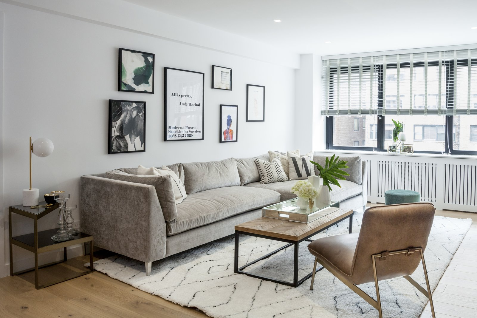 Living Room, Chair, End Tables, Ottomans, Sectional, Coffee Tables, Recessed Lighting, Table Lighting, and Medium Hardwood Floor Living Room  Upper East Side Oasis