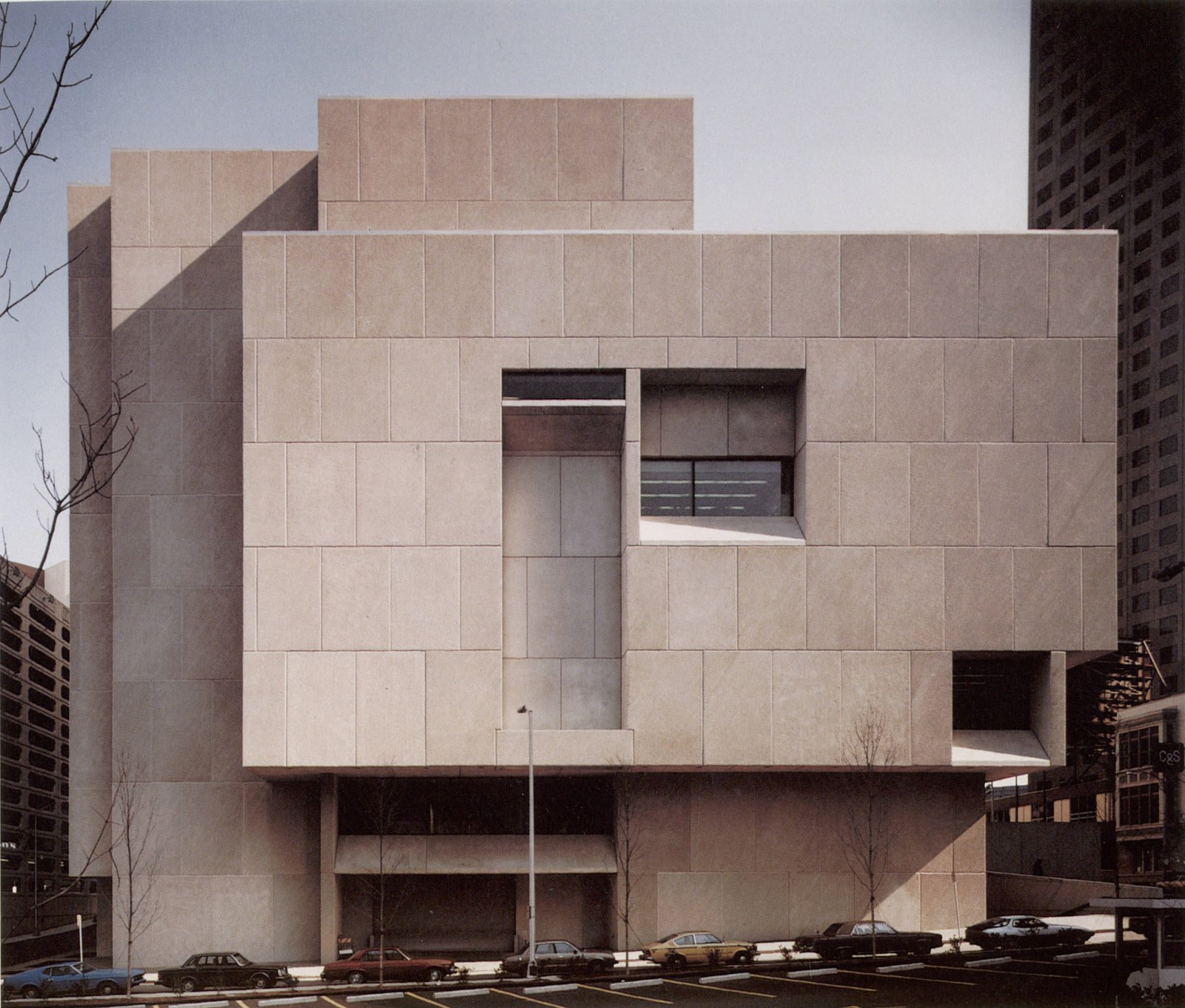 """The last structure that Breuer designed (he was too ill to attend the dedication ceremony), the Atlanta Central Library was an evolution of the style and shapes used for the Whitney, a sculptural structure of cubes right angles. The airy shapes, combined with the heavy massing of concrete, led Barry Bergdoll, the chief curator of architecture at the Museum of Modern Art, to refer to this type of construction as """"the invention of heavy lightness.""""  Photo 11 of 12 in Design Icon: 10 Buildings by Marcel Breuer"""