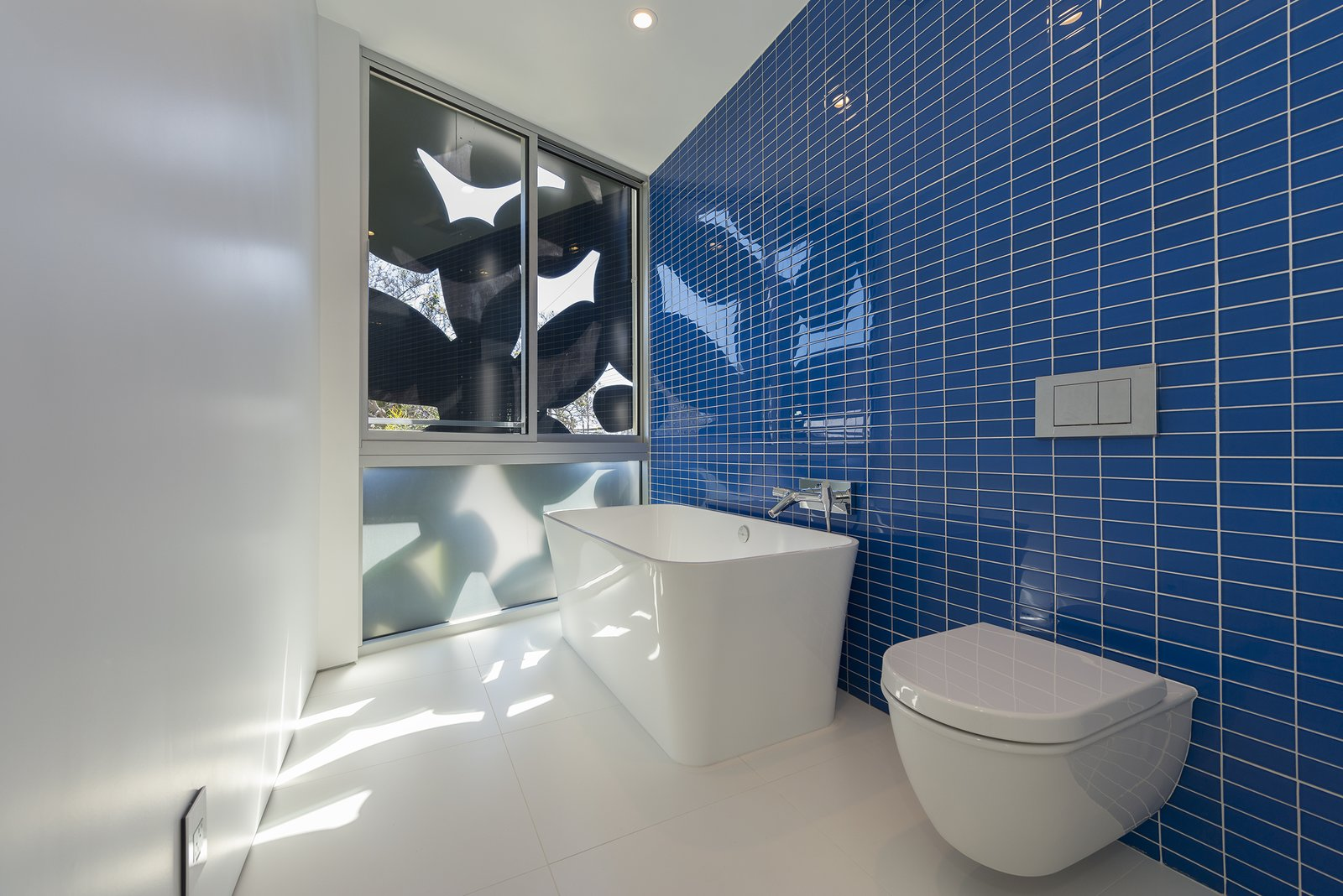 Bath Room, Porcelain Tile Floor, Vessel Sink, Freestanding Tub, Ceiling Lighting, Glass Tile Wall, One Piece Toilet, and Open Shower Glass-tile and porcelain bathroom  4016 Tivoli by Cameron McNall