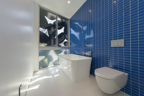 Glass-tile and porcelain bathroom