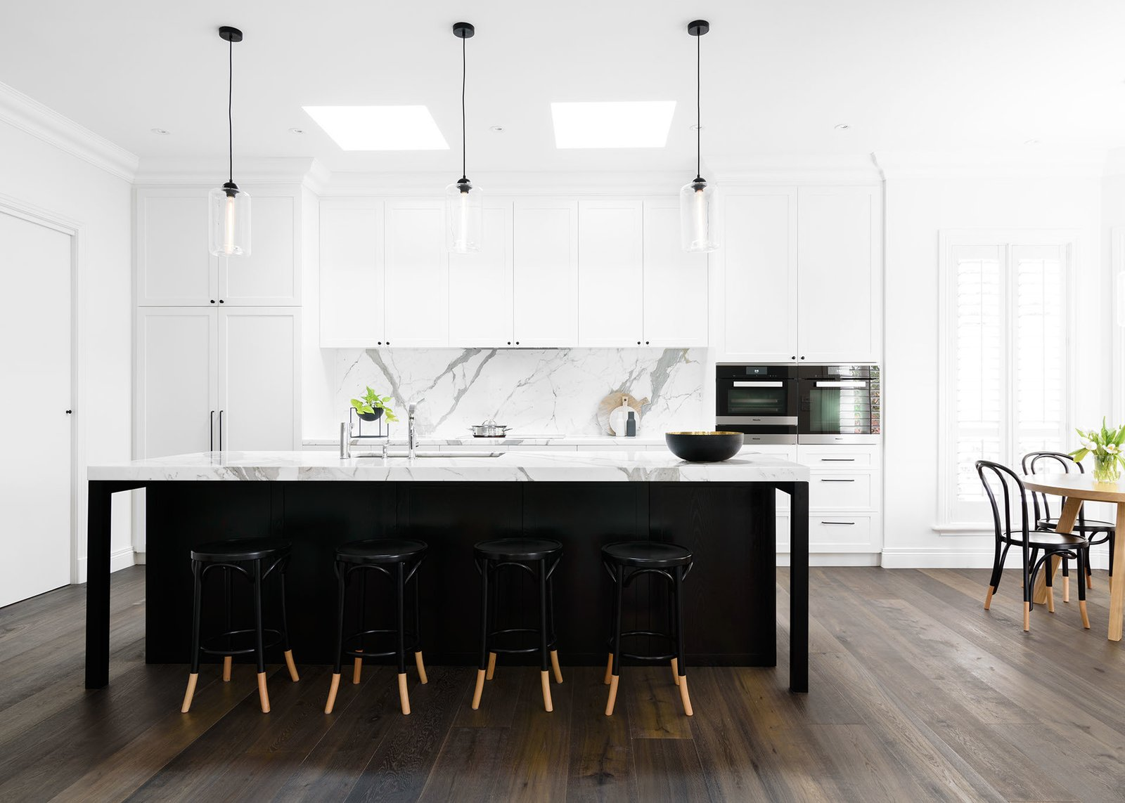 Kitchen, Marble, White, Wood, Medium Hardwood, Stone Slab, Pendant, Ceiling, Recessed, Dark Hardwood, Wall Oven, Cooktops, Range, Drop In, and Undermount Kitchen  Kitchen Drop In Pendant Marble Wood Photos from PRK Residence