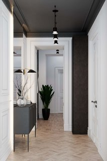 This minimal hallway's white paint, light wood floor, and mirrored walls make it appear larger than it actually is.