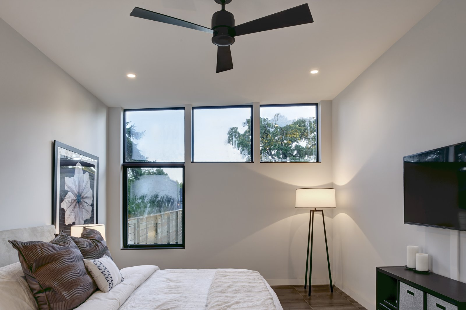 Bedroom, Bed, Lamps, Shelves, Storage, Ceiling Lighting, Recessed Lighting, and Porcelain Tile Floor Reconfigured windows maximize daylight in the bedrooms.  Koser I by Neumann Monson Architects