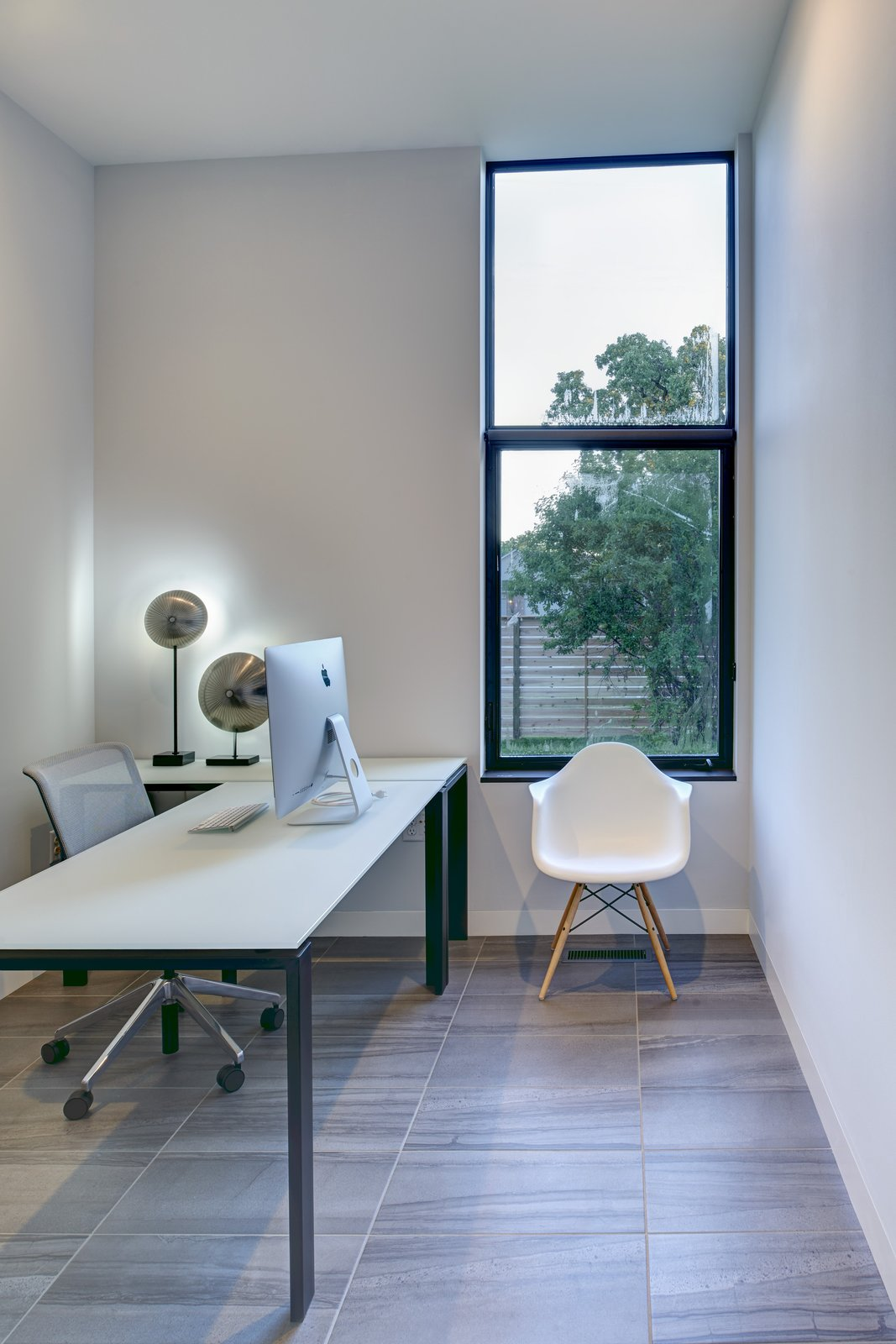 Office, Study Room Type, Chair, Lamps, Porcelain Tile Floor, and Desk A small office separates the master bedroom from the kitchen.  Koser I by Neumann Monson Architects