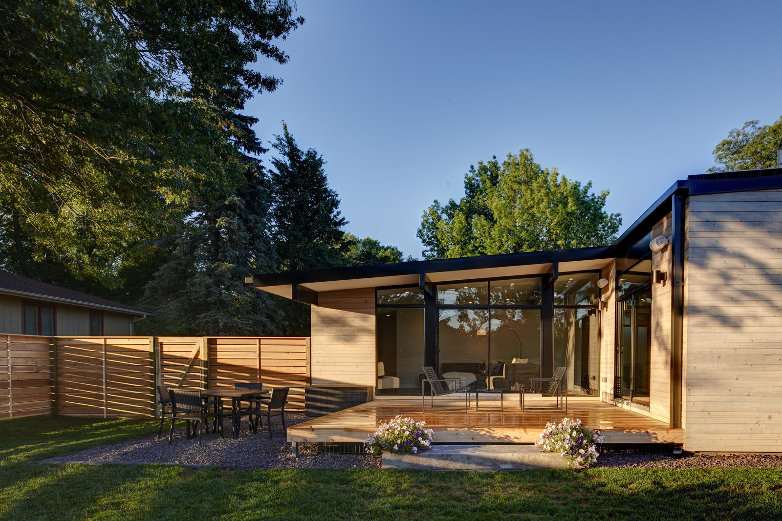 Exterior, House Building Type, Metal Siding Material, and Wood Siding Material A large deck provides exterior living space off the kitchen.  Koser I by Neumann Monson Architects