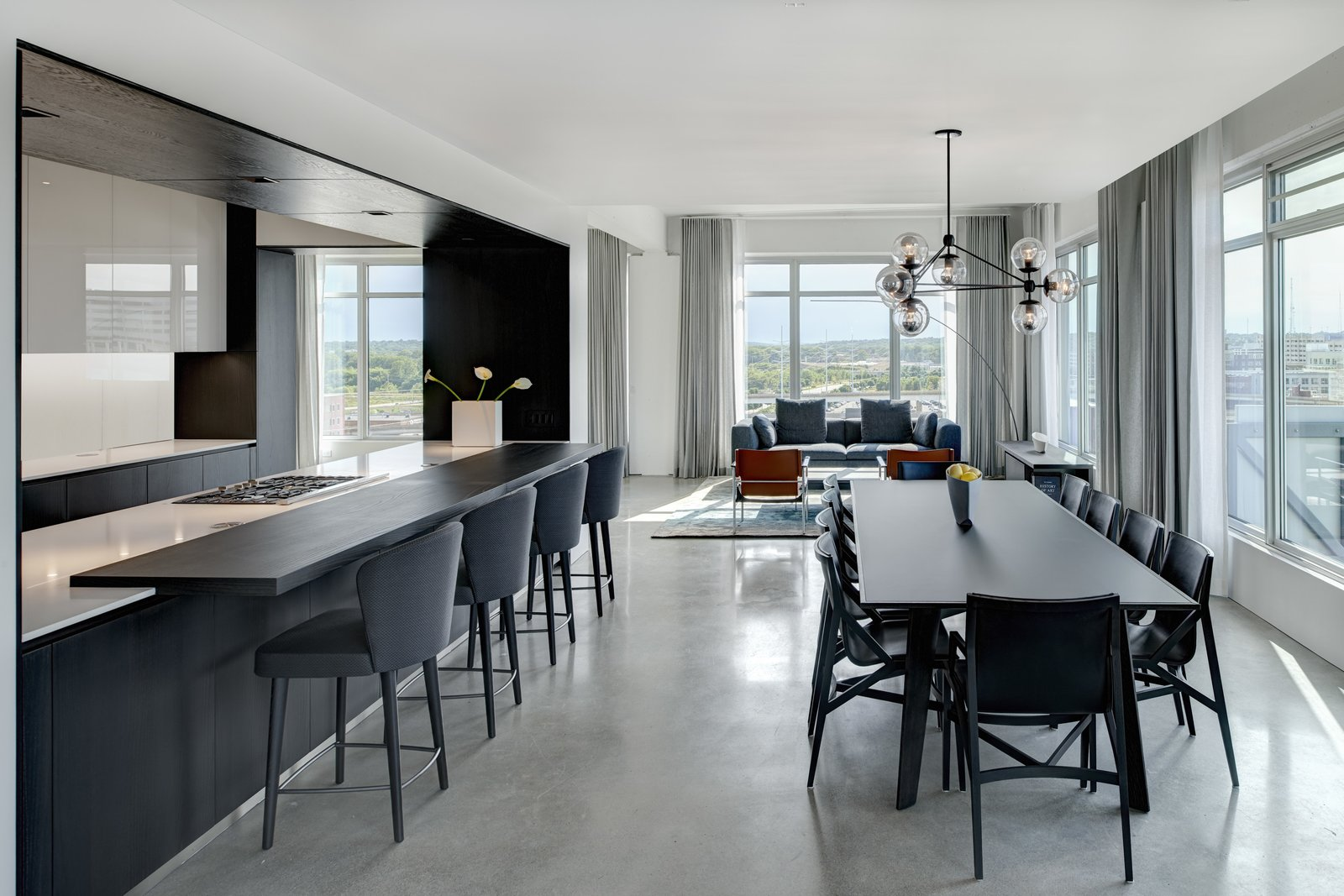 Dining Room, Chair, Table, Ceiling Lighting, Pendant Lighting, and Concrete Floor Social spaces are held to the perimeter to access expansive panoramic views.  Whiteline Residence by Neumann Monson Architects