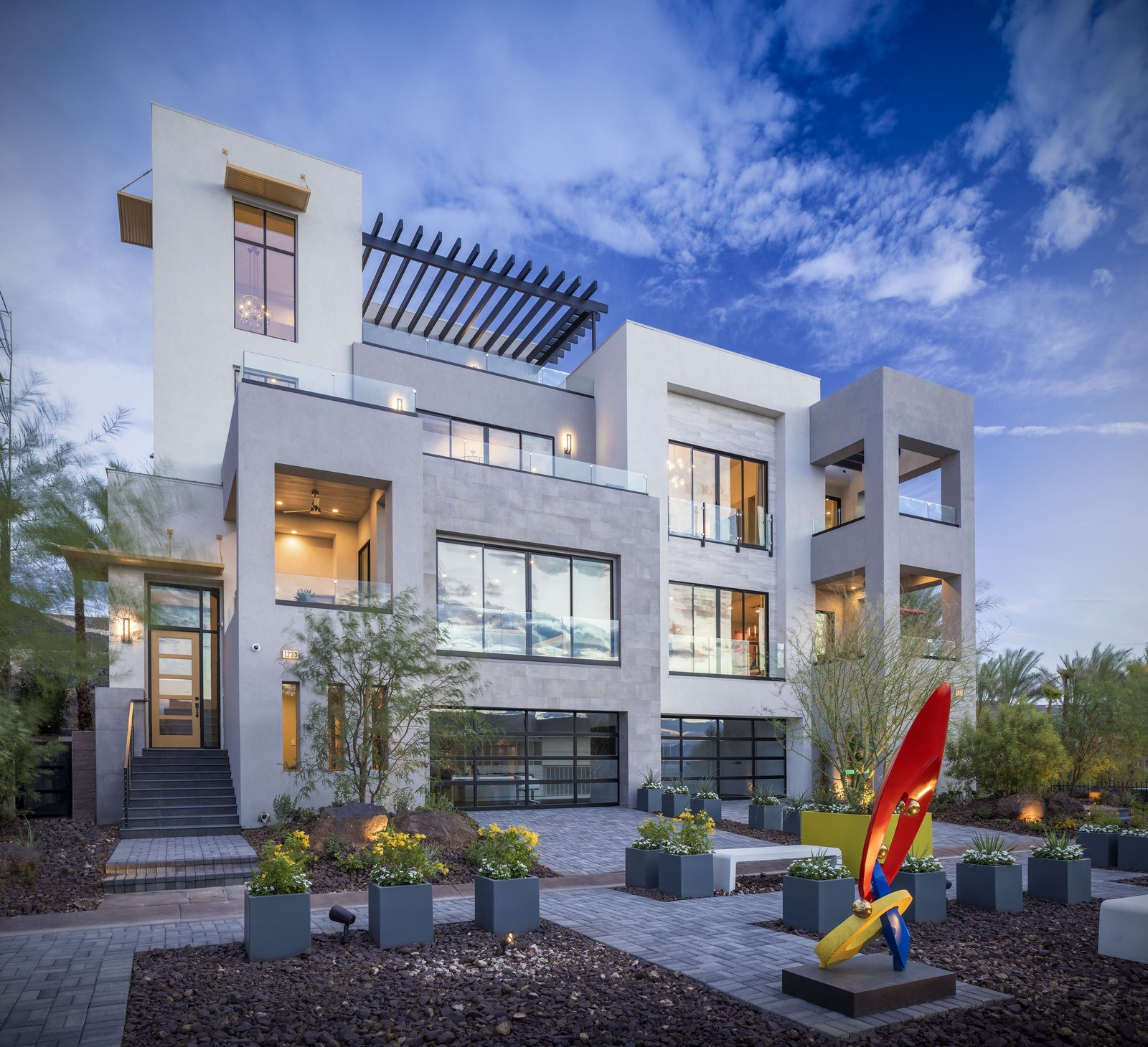 Exterior, Concrete Siding Material, Flat RoofLine, and House Building Type Pulling inspiration from the Greek island of Santorini, these townhomes are designed with simple forms, clean lines and a cool color palette of whites, creams and blues.  Vu at MacDonald Highlands by KTGY Architecture + Planning
