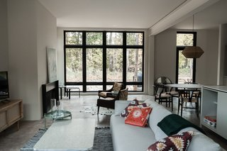Great room with floor-to-ceiling windows.