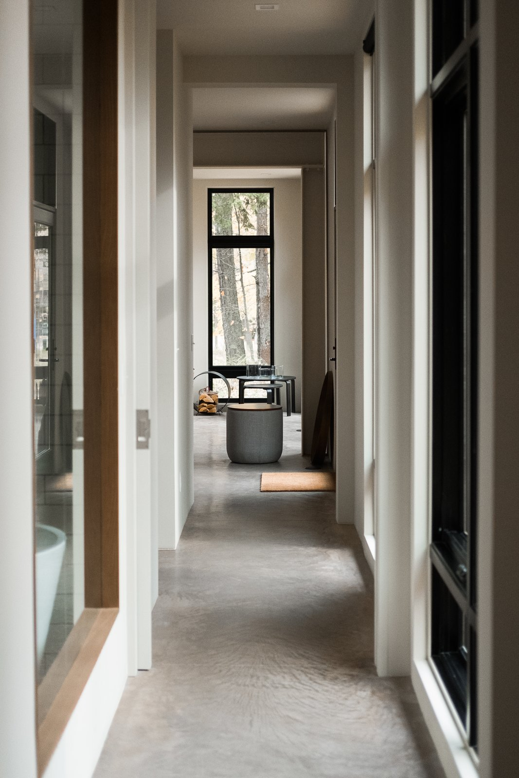 Hallway and Concrete Floor Hallway view from bedroom to great room.  North Shore #7 by Hygge Supply