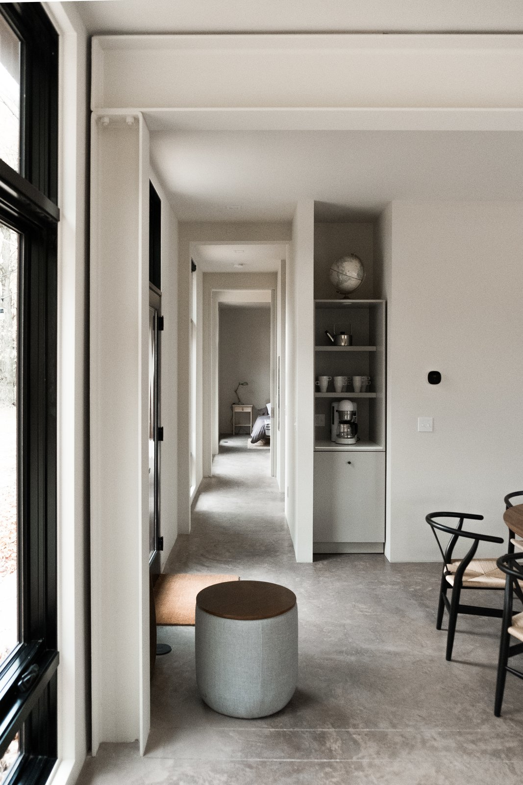 Hallway and Concrete Floor Hallway view from great room to bedroom.  North Shore #7 by Hygge Supply
