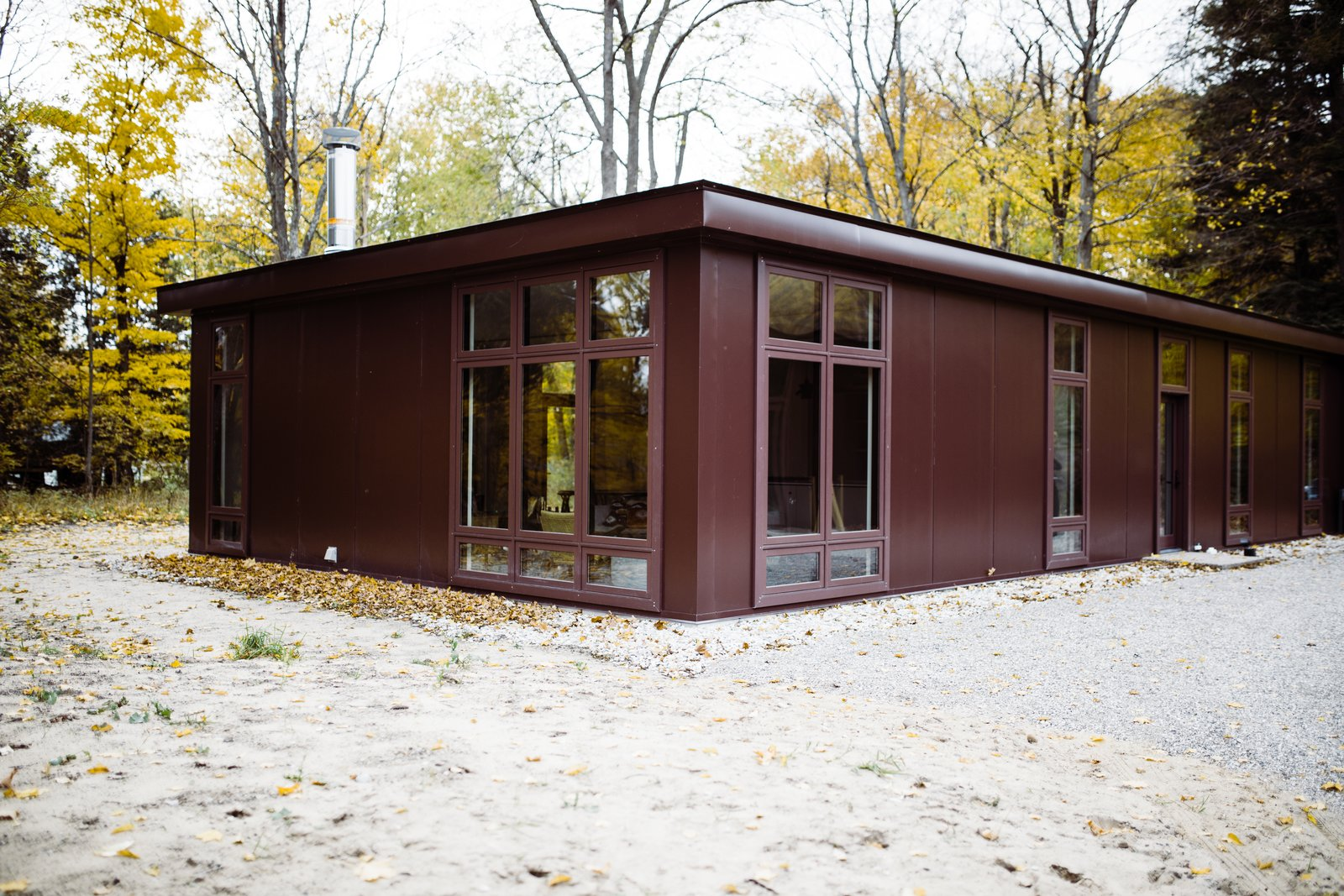 Exterior, House Building Type, Metal Siding Material, and Flat RoofLine Floor-to-ceiling windows line the walls of the structure.  North Shore #7 by Hygge Supply