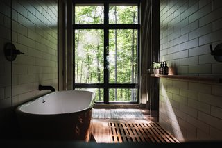 Master bath wet room with views of trees.