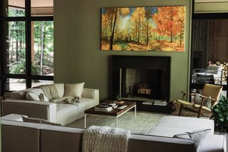Living room with steel mantel wood-burning fireplace.