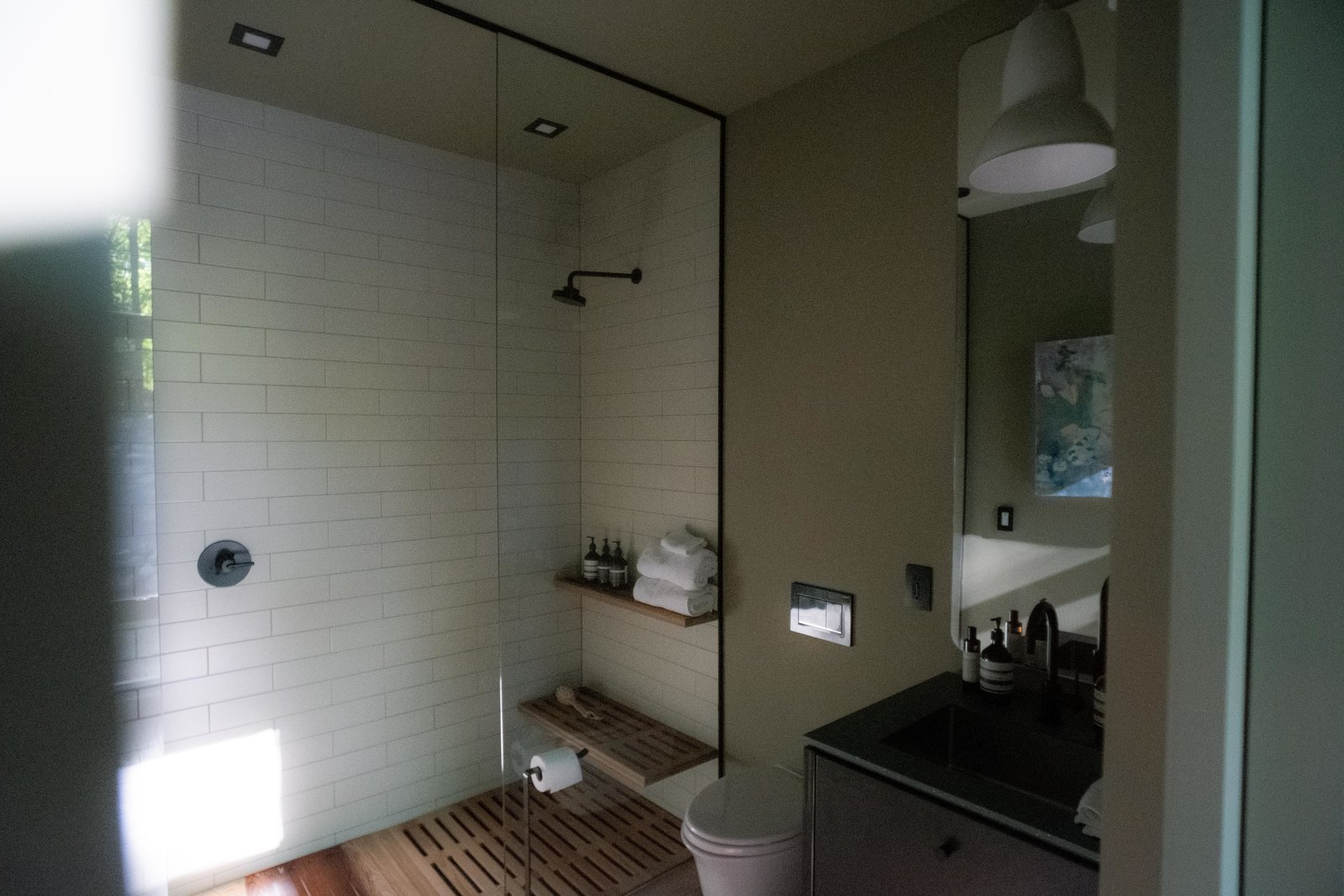 Bath, Subway Tile, Full, Open, Pendant, Undermount, Ceiling, Medium Hardwood, and Two Piece Guest bathroom with wood grate floor and shelving.  Bath Medium Hardwood Ceiling Pendant Subway Tile Photos from Birch Le Collaboration House