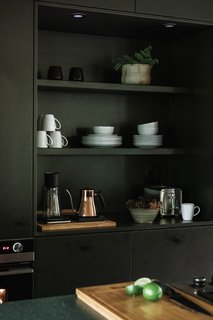 Hygge Supply cabinets with shelving inserts in kitchen.