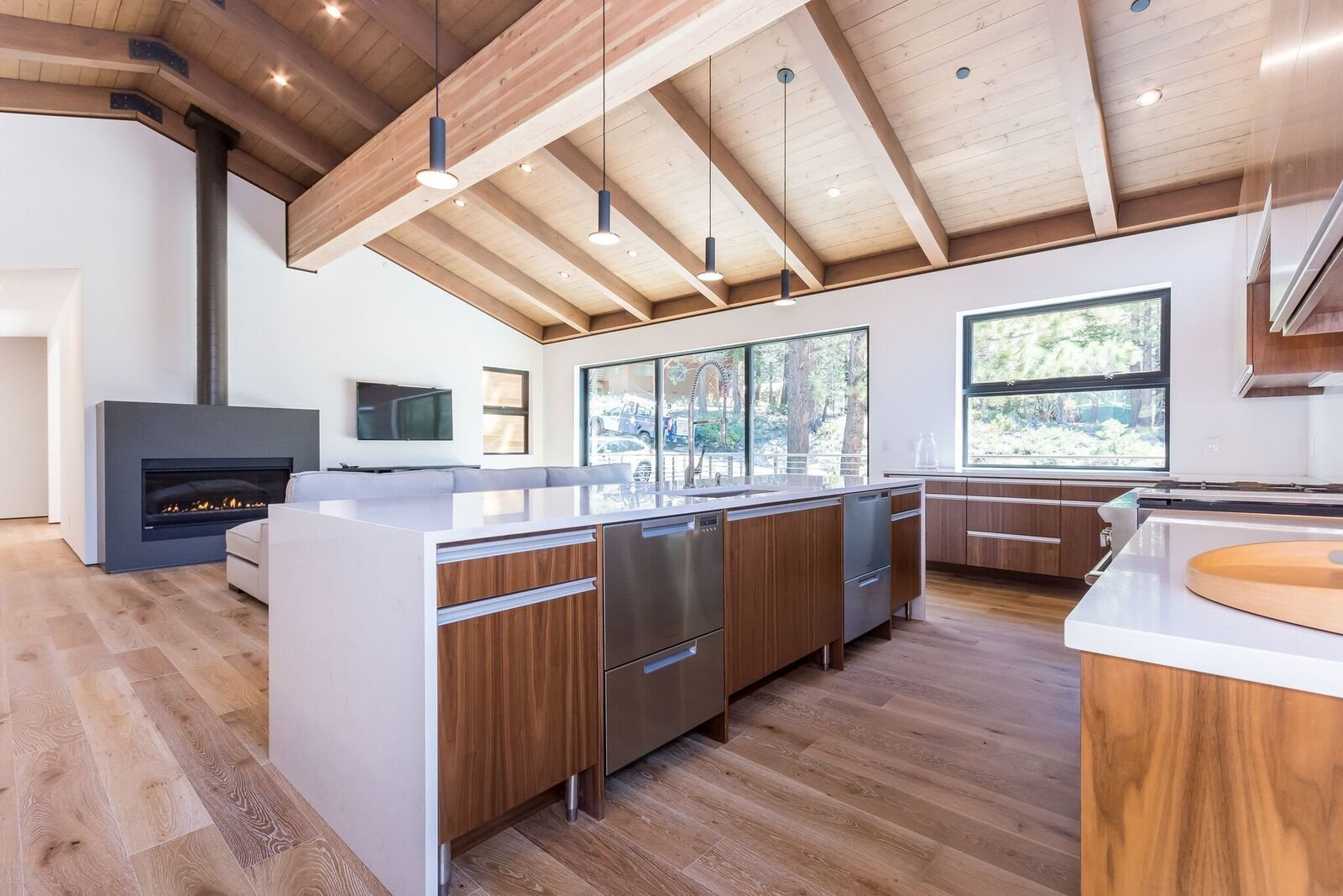 Kitchen, Quartzite Counter, Engineered Quartz Counter, Wood Cabinet, Ceiling Lighting, Pendant Lighting, Dishwasher, Undermount Sink, and Medium Hardwood Floor Dual dishdrawer units for holidays, large dinners, friends...  Mammoth Modern House 1